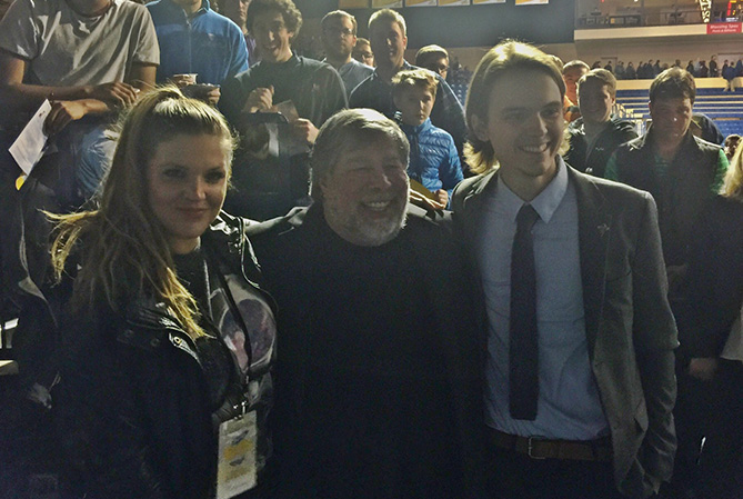 Devan Lutz (left) and Matt Sutter (right) interview Steve Wozniack at the Jesup Honors College Lecture Series
