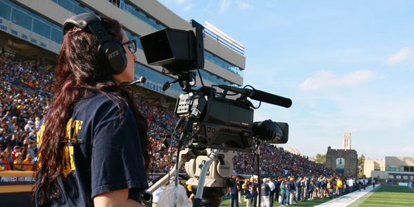 Student filming a Toledo Rockets football game