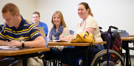 Student in a wheelchair sitting in class