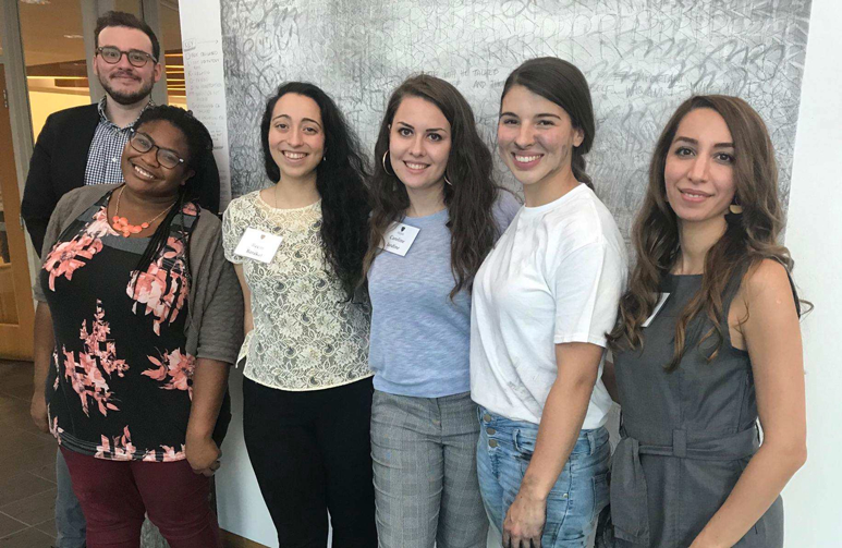 Photo of student artists who created work for the Faces of Trafficking exhibit, Robert Cummerow, Faith Goodman, Reem Barakat, Caroline Jardine, Rose Mansell-Pleydel, Tara Yarzand