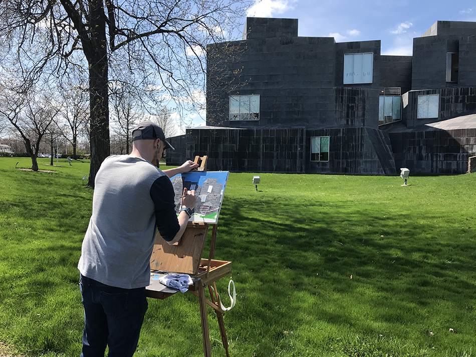 Student plein air painting outside the CVA.
