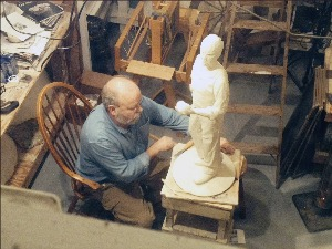 Tom Lingeman works on sculpture