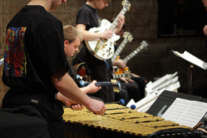 Percussion student playing with GuitArkestra ensemble