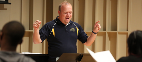 Photo of Dr. Brad Pierson demonstrating choral conducting at the University of Toledo Choral Conducting Workshop