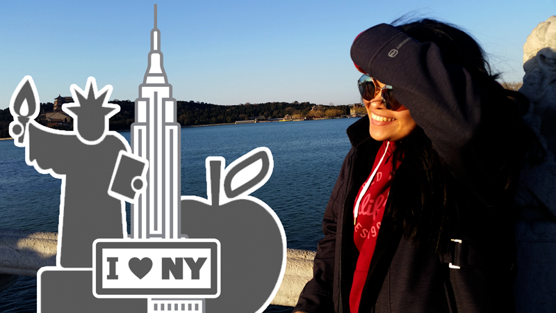 Photo of UToledo film alumna Eva Noria, 2018, with New York icons in the foreground