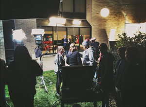 Faculty and students on a night shoot with guest filmmaker Simon Huber