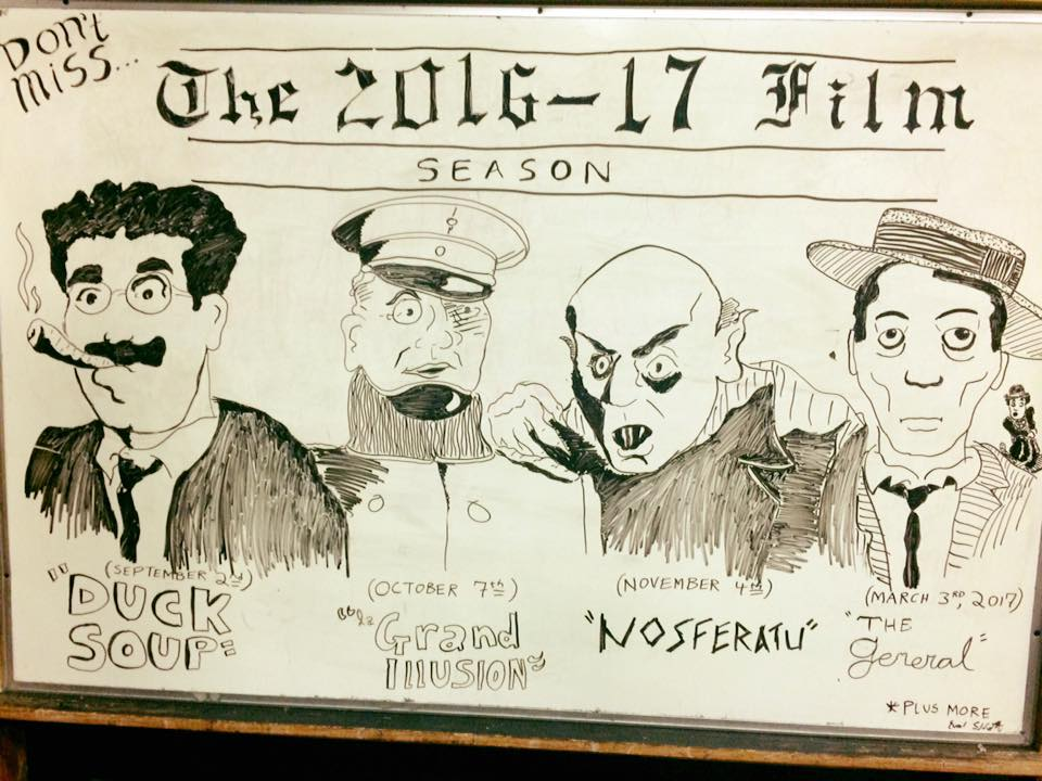 The art shown was drawn on a white board by talented student Evan Sennett, previewing our next season!