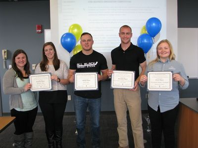 The winners of the 2016 business competition, left to right, Andrea Liedel and Hannah Ogden, Morpho Bag; Kevin Gibson, IceTyme; Joseph Strobbe, Quick Deploy, Casualty Carry Harness; and Mackenzie Miller, Freedom Model Trumpet.