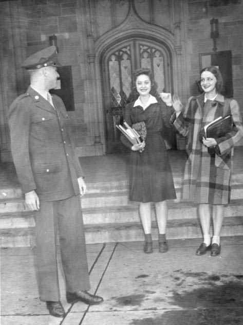 WW 2 soldier with two young women in front of University Hall.