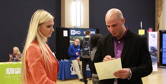 A student speaking with an employer at a job fair