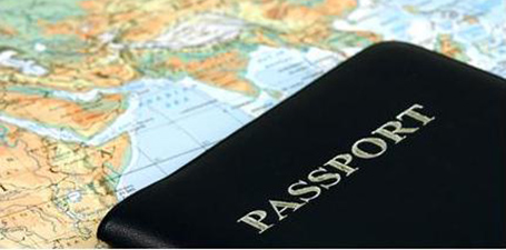 Picture of a passport with a map of the world