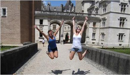Students jumping for joy while studying abroad