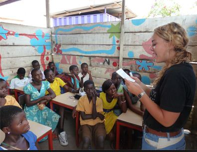 person teaching in a classroom abroad