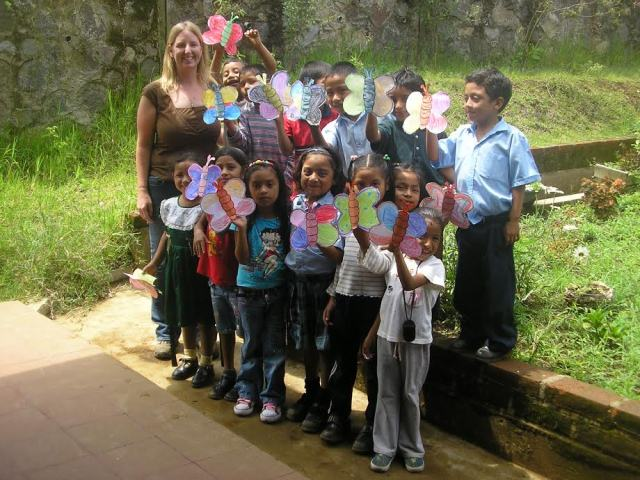 Laura with children holdin gup art work