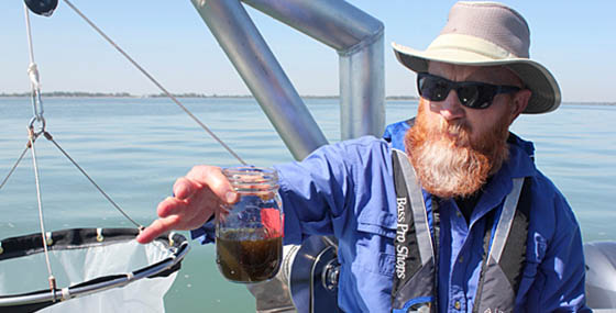 Tom Bridgeman showing a Lake Erie water sample