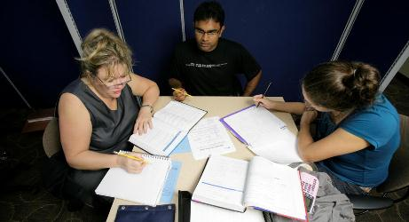 Tutoring of students sitting at a table