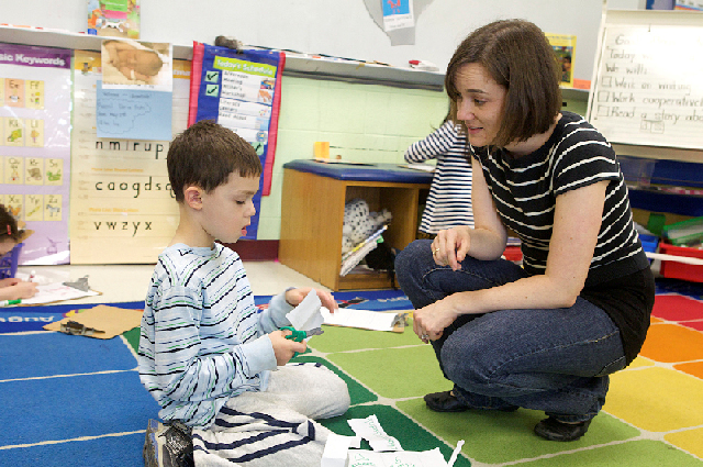 Special education teacher and student