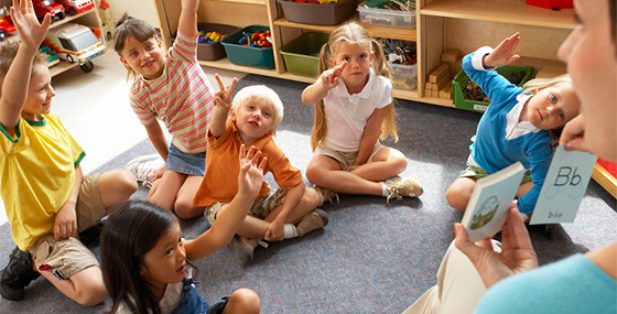 children sitting in a circle at a daycare