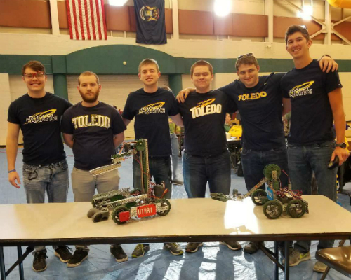 6 members of robotics team with robots