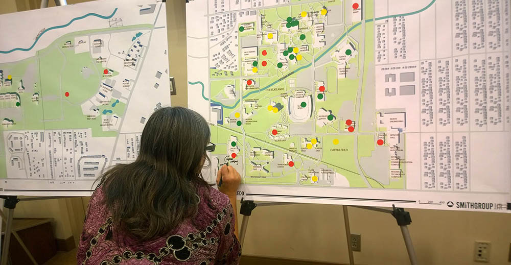 Women reviewing campus maps