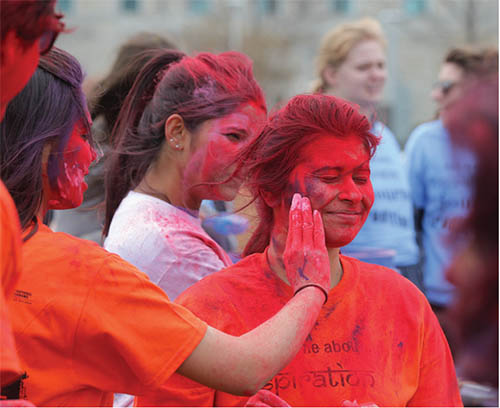 Students throwing colors during Indian student festival
