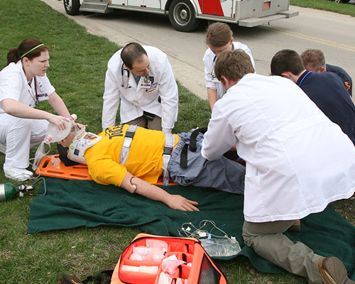 Students participating in a mock crash simulation