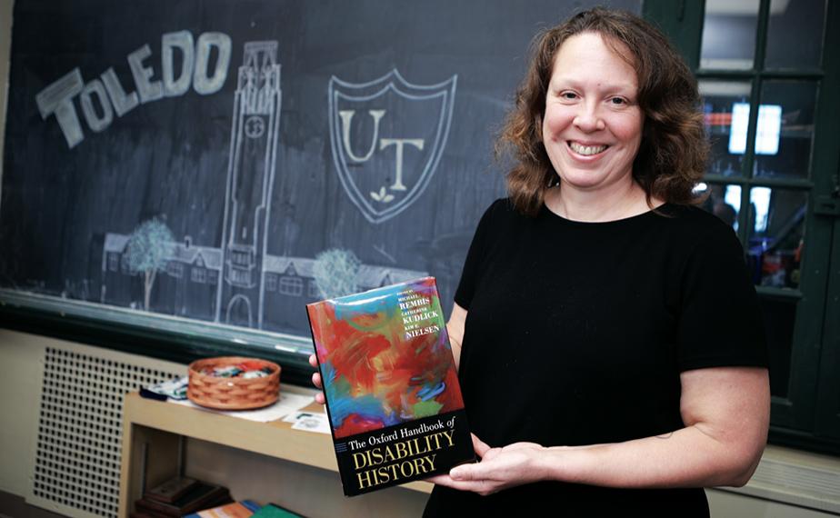 of Dr. Kim Nielsen holding Oxford Handbook