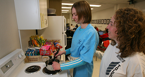 Photo of two female OT students cooking