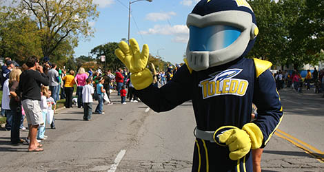 Rocky waving to friends at homecoming parade
