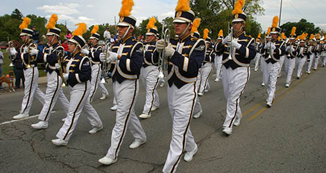 UT marching band playing at the homecoming parade