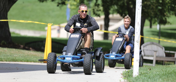students driving go-karts