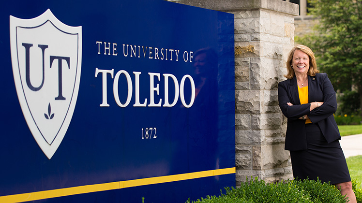 Dr. Sharon Gaber standing next to The University of Toledo sign