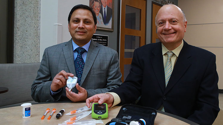 Dr. Shahnawaz Imam and Dr. Juan Jaume with an array of diabetes management tools.