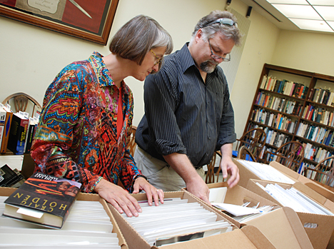 Author and UT alumnus Craig Holden and Barbara Floyd, director of the Canaday Center for Special Collections, looked through some of his papers he recently donated to the University.