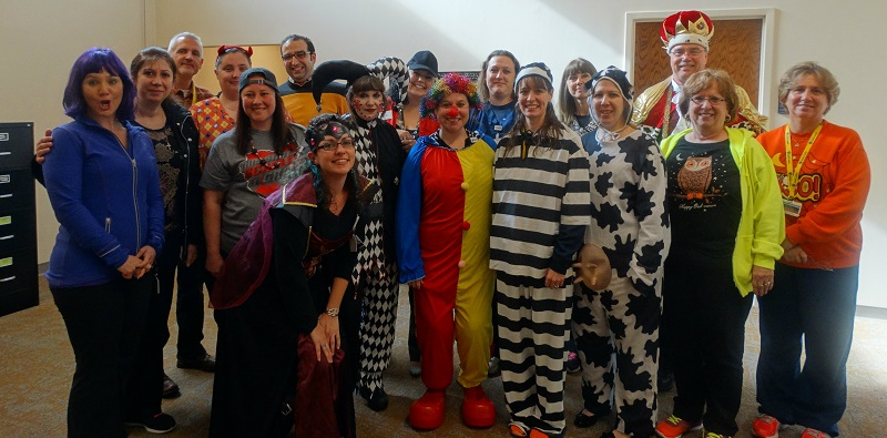 Staff members dressed for Halloween
