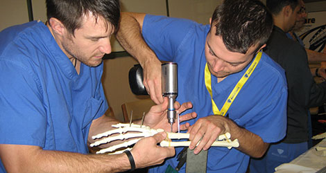 residents working on hand bone in lab