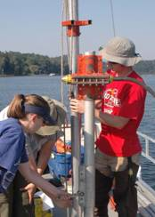 Geology students collect sediment cores