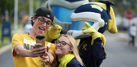 Students taking a selfie with Rocky and Rocksy