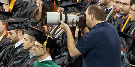 Dan Miller photographing commencement