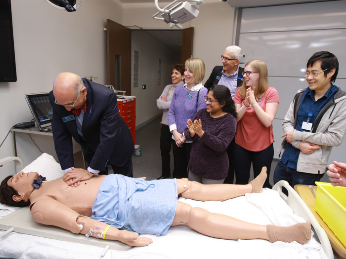 Faculty member demonstrating healthcare to students