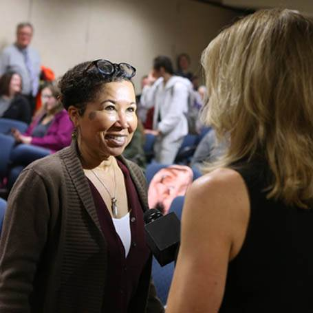 Dr. Celia Williamson being interviewed by a local TV station reporter