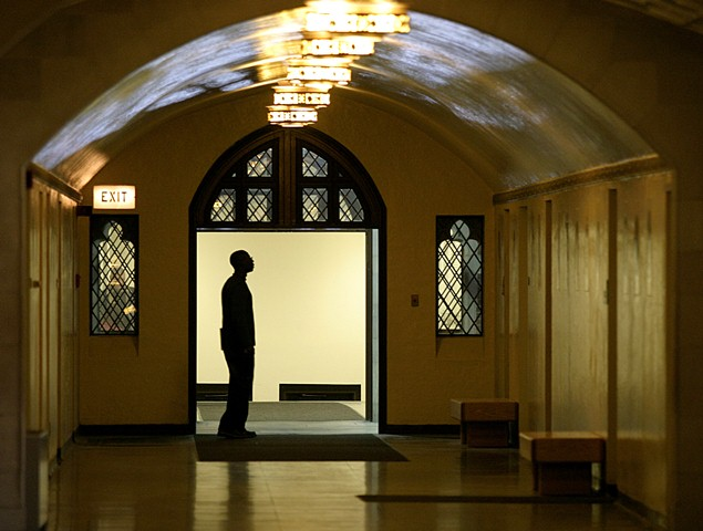 Photo of person standing in hallway of University Hall