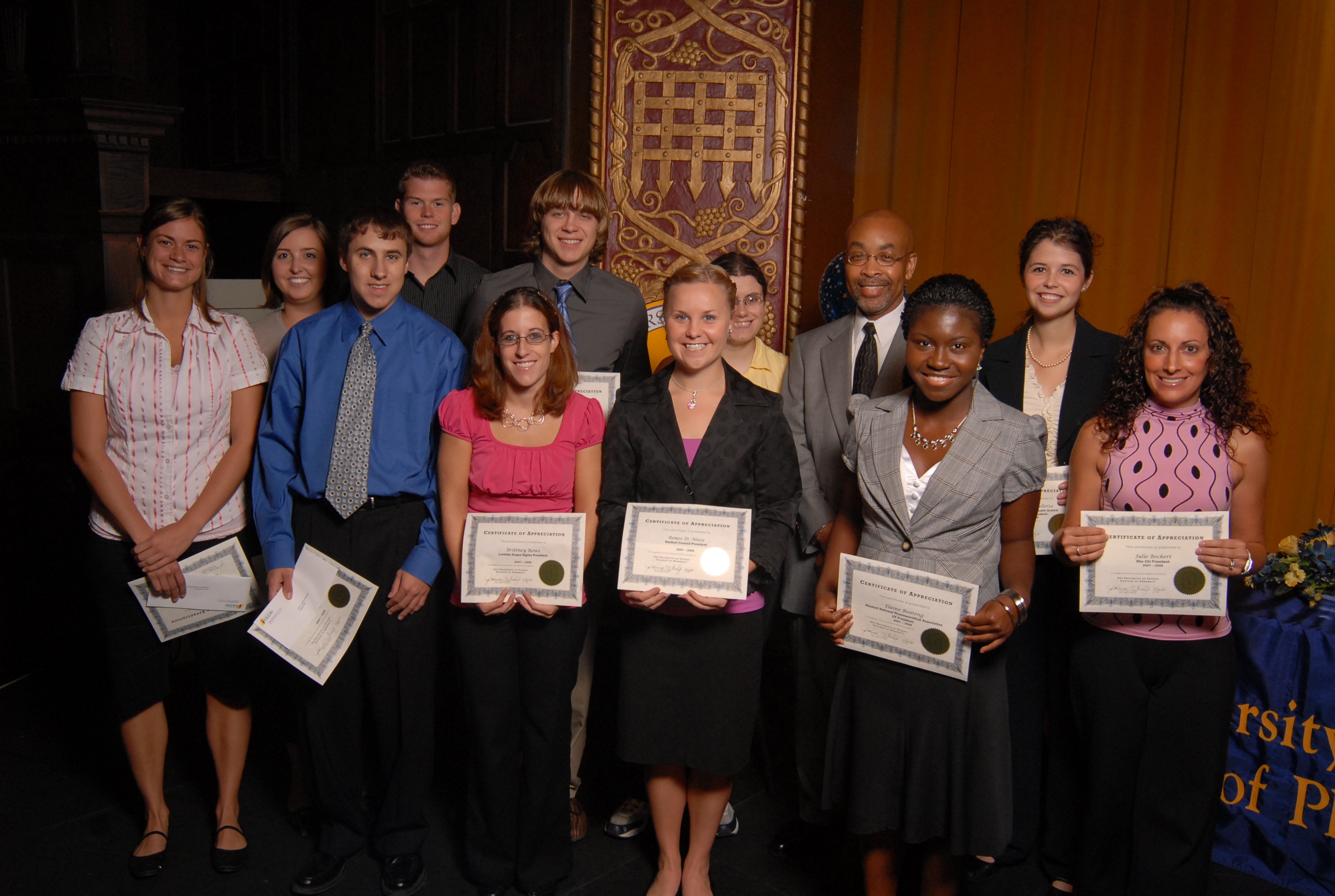 photo of students with scholarship certificates