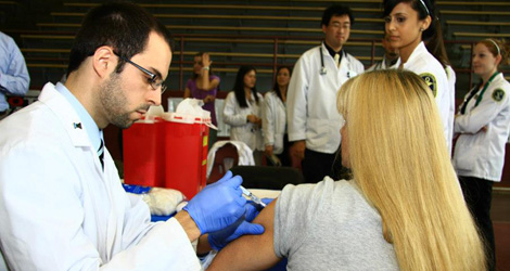 student giving vaccination image