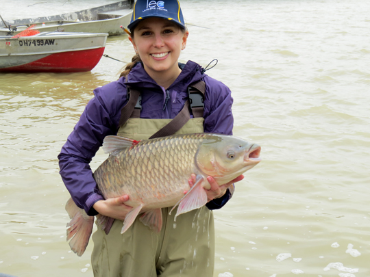 Nicole King Holding Grass Carp Captured in Early Spring
