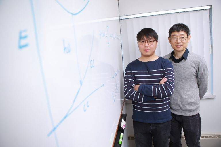 Dr. Xiaoming Wang, left, and Dr. Yanfa Yan, right.