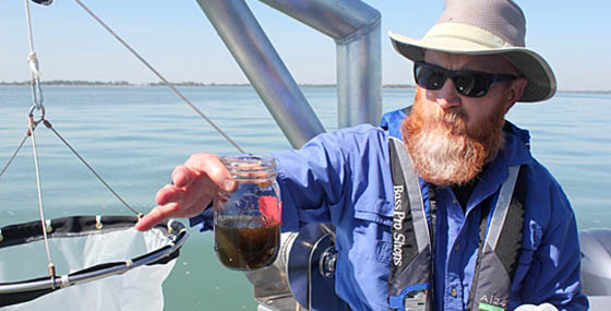 Dr. Tom Bridgeman showing water quality of Lake Erie