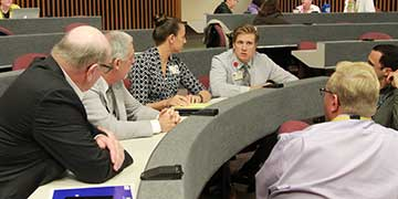 Group of people at a discussion session