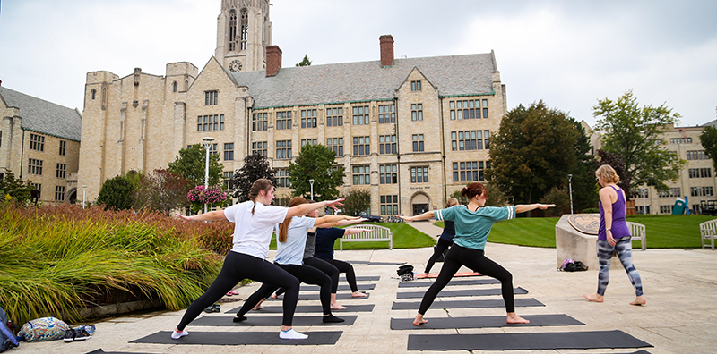 Students doing yoga at Centennial Mall