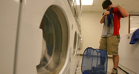 student doing laundry